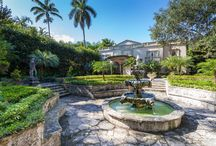 COCONUT GROVE REAL ESTATE - 3940 DOUGLAS ROAD / A beautiful Italian Villa located in Coconut Grove is one-of-a-kind with gorgeous gardens. The interior of the home has grand living and entertaining areas with marble floors, a formal living room with a fireplace, a formal dining room, and a sunlight family room with French doors leading to the keystone patio and pool. The expansive master suite has a large dressing room/sitting room along with a walk-in closet and a beautiful marble bathroom. Entertain out of town guests in the guest house.