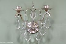 Klassieke wandlampen met kristallen / Exclusieve wandverlichting rijk behangen met kristallen.