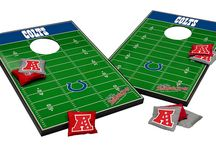 Football Corn Hole Toss / Different teams customized on the football corn hole toss game, where to buy, rule of play, product details, team info, and links to the team's fan shop.