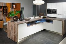 Kitchen Islands / Want to make a bold statement in your kitchen? Create a border with ALNO's base cabinet fronts and contrasting side panels / countertop