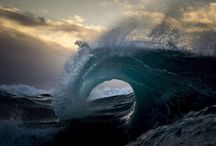 The Moody Ocean At Daybreak / Australian photographer Ray Collins pulls himself out of bed in the early hours, while the darkness still falls heavy outside. By the time the light trickles from behind the horizon, Collins is treading water, his body rolling in the heaving ocean. He holds his camera and waits for the perfect set. He analyzes the turbulent seas in search of the morning's most photogenic peaks and perfect breaks.  | www.godsfolder.com #GodsFolder
