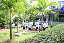 Year 4 - Rice Planting / The area behind the Primary building is to be transformed into a garden/outdoor classroom with the aim of educating students across the school about agriculture, sustainability, food and many other things. As part of the first step in our plans, Year 4 took part in planting some rice. This will help the students to develop an awareness of where one of their main sources of food comes from and the time and effort that goes into growing it.