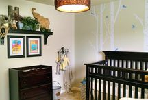 """A Baby Boy's Nursery / This family wanted a room where the newest addition to the family could grow up in without having to change """"themes"""" every couple of years. Mom & Dad already had most of the furniture. They just needed a few finishing touches to pull everything together. We incorporated art that his big sisters created for that personal family touch. Birch trees, sticks and stones, rustic lighting and several animals all help to create a rugged yet playful feel to the space. A big cozy chair finishes it all off."""