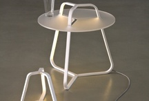 TOY | Martinelli Luce / Table lamp, indirect diffused light, designed for Led bulb, 3000°K. Metal painted structure. Floor standing lamp, indirect diffused light, designed for Led bulb, 3000°K with satin methacrylate support plane of 50 cm diameter. Metal painted structure.  ADI Design Index 2011 Good Design Awards German Design Award 2012 IF Design Awards Second Prize Young & Design