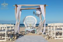 Bohemian Beach Wedding Style / Bohemian Beach wedding styling, peacock chair hire, wooden boxes, lanterns aisle styling, bamboo wedding arch, wedding chair hire, heshan wedding styling