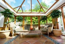 Orangeries / An orangerie is a further imaginative option for those looking for something a bit different. Consisting of a partial solid ceiling but still retaining a glazed roof, orangeries give a more enclosed feeling while still flooding the room with natural light.