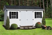 Vinyl Deluxe Buildings / Our Vinyl Deluxe offers you a tall wall with an attractive overhand. This is one of Sheds Direct's best sellers! If you are looking to enhance your backyard and add storage, look no further!  TIP: taller walls make bringing out your lawn tractor, golf cart, or other large items even easier
