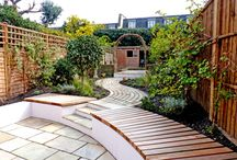 Old Town by Really Nice Gardens / We designed this Clapham Old Town garden to have a cottage garden-like feel with a windy path and space for a terrace, flower garden and vegetable patch.