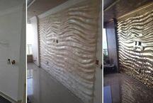 Proyecto Ouro das Dunas / Pared realizada en yeso y revestida por completo en hoja de oro, esta pared fue proyectada desde un inicio por Ampio Campo Design inspirada en las olas del mar y las arenas doradas.  Proyecto realizado en Brasil.