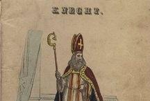 Sint Nicolaas en zijn knecht (1850) / De bedenker van het prentenboek 'St. Nikolaas en zijn knecht' was Jan Schenkman. Hij staat bekend als de bedenker van het moderne Sinterklaasfeest. In zijn prentenboek voerde hij oude en nieuwe elementen in als de stoomboot uit Spanje, Intocht, inkopen doen bij de banketbakker, het rijden van Sint (en zijn Knecht) over de daken, het grote boek, het straffen van stout en goed gedrag, cadeautjes voor arm en rijk, het strooien van lekkernijen en het gooien van pakjes door de schoorstenen.