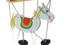 Horse Toys / Horse toys.  Rocking horses, spring horses, stick horses, ride on horse with wheels, plush horse toys, horse games, barbie horse sets, Breyer horses, rodeo horses, horse barn and stable playsets.