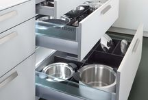 Kitchen cabinets pots and pan under cooker like that idea