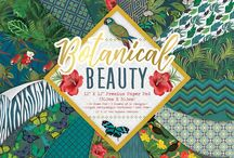 First Edition Botanical Beauty / Embrace the essence of tropical rainforests and warm climates with First Edition's decadent papercraft collection, Botanical Beauty. Designed in a rich green and blue colour palette, Katie Pertiet's selection of nature-inspired designs offer repeat patterns of tropical leaves, parrots, tropical flowers, fluttering butterflies and more.