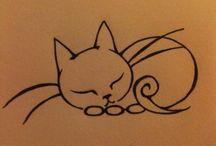 Katzen-Tätowierungen