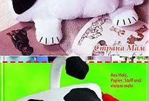 cuscino e bambole in stoffa