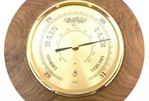 Timber-Treasures Dinton walnut barometer 16cm / These barometers are one of Timber-Treasures' signature lines, made in our Bristol workshop and signed by the maker, David Gladden. Using high quality brass German instruments, and expert workmanship, these barometers are beautiful and practical instruments, that can predict the weather using air pressures. Hand turned frame in Walnut from Dinton, Wiltshire. Works continuously without the need for batteries Dimensions: 16 cm diameter x 4 cm* *handmade disclaimer