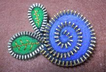 Zip it / Brooches made from up-cycled zippers / by Leah Levine Brown Cady