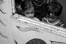 Faces with images / A click here and a click there. Capturing souls through lives fast pace.