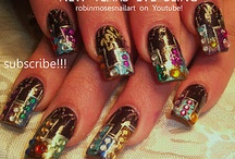 """NEW YEAR nail art pictures and tutorials / i did not want to have a playlist for NEW YEARS exclusively, but i have to. the """"hot"""" and """"diva"""" """"elegant"""" and """"flowers"""" gallery all are great galleries all jam packed with designs that are great to ring in the new year but...it feels weird not to have """"new year nail art"""" up and ready to look at when christmas is over and we need to make our resolutions :D i upload new designs every monday, wednesday and friday so subscribe and learn and see new art all of the time. if you copy, please always say who inspired you (for me, all i ask in return for what i teach is for you to say """"inspired by robin moses"""") that helps me get my name out so i can teach full time and it ensures you keep learning art and having fun :D my love and thanks for all helping achieve my goals! :D <3"""