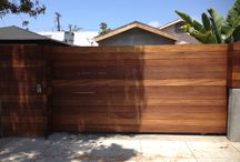 Driveway Gates / contemporary style driveway gates made from rough Iron and redwood