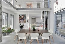 Compo Beach Modern / This custom contemporary in the Compo Beach area of Westport is home to a visual artist who had great input – her signature red pops up everywhere! – in the unique designs of Vita Design Group and Kathy Davis Groener Interiors.  Oversize windows, balconies and a wraparound deck invite the outside in, and extend the interior living space into the outdoor setting.  Highlights include a modernistic glass elevator, reminiscent of a bank pneumatic tube, and a zen-inducing central courtyard.