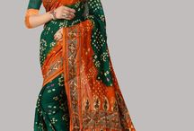 Bandhni Sarees / Bandhni Sarees or tie dye sarees are made in states  Gujarat & Rajasthan in India. It is a unique art where parts of fabric are pinch tied in traditional pattern to mask them while dyeing the fabric in multiple colors, which creates motifs like branches birds or geometrical designs.