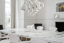 Vaasa / The Vaasa chandelier by Cameron Design House. Symmetry and minimalism is the underlying aesthetic of the Vaasa pendant. Its evenly placed rings descend either side from the centre with light released through hundreds of individually cut and hand laid crystal profile diffusers.  Bespoke options and design service available.