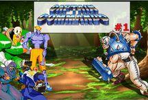 """Captain Commando / Capitão Comando é jogo de arcade produzido pela Capcom em 1991, tendo como personagem principal Captain Commando (Capitão Comando). É um jogo no estilo beat 'em up. O jogador escolhe um dos 4 membros do """"Team Commando"""": Captain Commando, Ginzu (Shô), Jennet (Mac) ou Hoover (Babby Head)."""