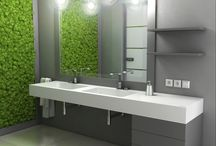 Modern bathroom interior / Gray bathrooms are a hit this season. In this arrangement on gray wall was placed a large, square mirror. Under it found a double stand LUXUM sink with traditional drain. White sink fits the gray color of the walls, cabinets and shelves.