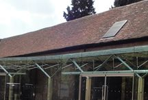 Project: Chicheley Hall / A glass extension using a complex system of timber and steel to support it to these 16th century, Grade II listed barns at the Royal Society headquarters