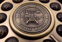 Diana of Mileto / It is the imitation of a push-button telephone. The classic reciever and holder fork with a classical designed house is suitable for the modern telephone network standard. The dial in the middle shows an embossment of an antique telephone. The reciever and the lineside cable is rj standard and joins the apparate with a plastic socket.