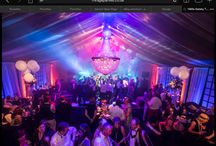 Gatsby themed party / Over 2 areas of 20m x 15m. One side mansion party area, other side street scene.