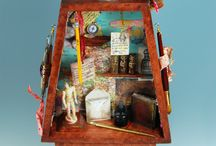 Shadow boxes, personal shrines / Shadow boxes, match box shrines, assemblage boxes, nichos anything with compartments and heartfelt trinkets often found. Some have religious reverence, display objects personal to the creator or cabinet of curiosities.