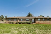 3041 River Road, Shelby, NC 28152 / 3041 RIVER ROAD, SHELBY NC 28152! Full Brick Ranch w/ Full basement located right on Riverbend Golf course! Features 3 bedrooms and 3 full bathroom. Master Suite with his and her closets and dressing area. Eat in Bar in the Kitchen with stainless steel appliances, breakfast nook and bay windows! Cozy fireplace in the Den! Large backyard with patio, deck and garden area w/ walkout basement. Located on over 1 acre