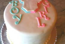 """Cakes to Surprise Moms and Dads / Boy?  Girl?  The inside of these cute """"gender reveal"""" cakes let you and all your guests in on your little one's secret. Gives us a call and we'll work with you to make this a wonderful surprise.  / by SweetStory Bakery"""