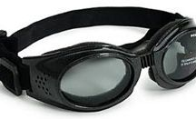 Doggles Sunglasses / Doggles Sunglasses are protective eyewear for dogs. Unlike ordinary sunglasses for dogs, Doggles actually protect dog's eyes from wind, UV light and foreign objects. All Doggles sunglasses have flexible, snug-fitting frames, which have foam padding against the face. Doggles have shatterproof and anti-fog lenses, adjustable elastic head and chin straps for a secure fit. Try Doggles Lens Cleaner, Doggles pet Sunscreen, and Doggles Wearable Ionizer. / by EntirelyPets.com