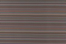 Robert Allen Contract Color Library Truffle-Hyacinth-Caramel / Robert Allen Contract presents a dynamic new Color Library featuring Truffle, Hyacinth and Caramel - filled with crisp geometrics in varying scales, layered compositions with organic undertones and rich, nuanced color. The collection explores the many ways to achieve multifaceted color through pattern. New motifs include a charming riff on the Celtic infinity knot, a geometric with aerodynamic shapes in subtle hues and a jacquard weave that mimics the hand painted look of Batik brushstrokes.