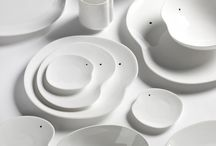 Tableware - Facing Food by Roel Vandebeek / Feel how the serving set, designed by Roel Vandebeek balances on the border between art and design. The basic forms, imperfect circles, enriched with a simple black spot, evoke a suggestive face. They have a conversation, as it were, with each other, the users and the food. Awarded with the Henry Van de Velde label for best design 2013