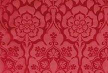 Red British textiles / A range of red period fabrics including damask silks.