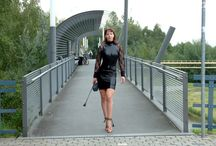 Latex - Dress and 6in high heels / Pantera in an short Latex Dress, bare legs and bronce colored 6inch high sandals outdoor in public with dog.