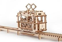 Ugears Wooden Model Kits / Awesome model kits that don't need any glue or fasteners.  The pieces snap together and have real moving mechanics.