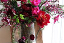 Red, burgundy flowers and wreaths