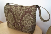 Diaper Bags and Messenger Bags / by Tina Razzell