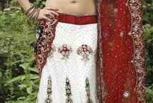 Latest #Lehenga Cholis in White / Style - Lehenga,Color -White,Red,Blouse-Satin,Fabric -Net,Work-Heavy Embroidery Work,antique work,golden cutdana work & golden moti work,lace work. bit.ly/1P2b3D8