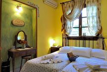 Double Rooms IN KRITSA HOTEL / Hotel Kritsa has totally 8 rooms completely renovated with a smart arrangement, soft colors, elegant furnishing and a view to the fantastic square of Portaria or the traditional mansions of the village.