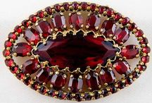 Czech Garnet / Garnets, one of the world's most ancient gems, come in a dozen varieties - but none is more precious than the fiery-red Pyrope variety which has been mined in the mountains of Bohemia for over 600 years. The Bohemian garnet, found in royal jewellery collections around the world, is given to visiting statesmen and every year thousands of tourists buy Bohemian garnet jewellery for someone special.....