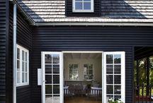 Dark grey/black houses