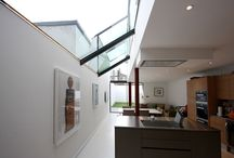 Project: Chaldon Road / A modern side infill extension with double height rear glass facade using sliding glass doors and structural glass connecting to a long structural glass roof light