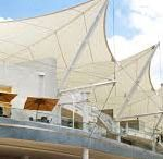 Tensile Fabric Structure / Ekra Decor - Established in the year 1998, are well known by its name in the field of design and construction of Tensile structure, Parking Shades, Polycarbonate Structure, Domes, Gazebo, Tensile membrane structures. Now we registered as a EKRA DECOR in Gurgaon, New Delhi, India.