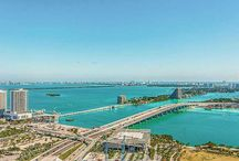 SOLD ~ 900 Biscayne Blvd #4310 / LIGHT & BRIGHT High-End Finishes! Hi-floor small 2 Bed/ 2 Bath w spectacular Biscayne Bay Water Views.  10' Ceilings. White Glass floors throughout. Open Floorplan w/ White Lacquer Italian Kitchen. Gorgeous Custom White Oak Wood Closets. Designed by infamous Sam Robin w/ 5 Star amenities-2 Pools, Coconut Palm Garden, Fitness Center w/ Decleor Spa, Private Theater, Children's Playroom & Resident's Club Lounge. | Listed For: $439,000